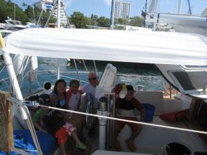 A Mexican family on holiday visits just before departure in Acapulco.