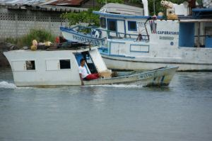 A fairly casual fisherman, barely afloat in Puntarenas, Costa Rica.