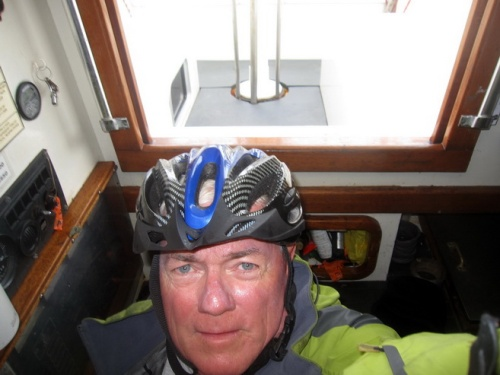 It was rough enough where the oceans meet. I've been knocked out once, off the coast of Ecuador, and did not like the whole deal. Down below I'll wear a helmet. On deck, sometimes. The biggest worry for a singlehander is falling and all that comes with 66 year-old bones and steel decks.