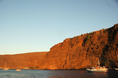 The rocky, forbidding coastline and hills of St. Helena. Nap Bona is buried up in those rocky hills.